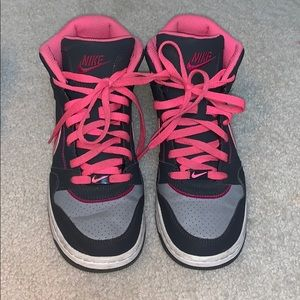 Pink and gray Nike high tops